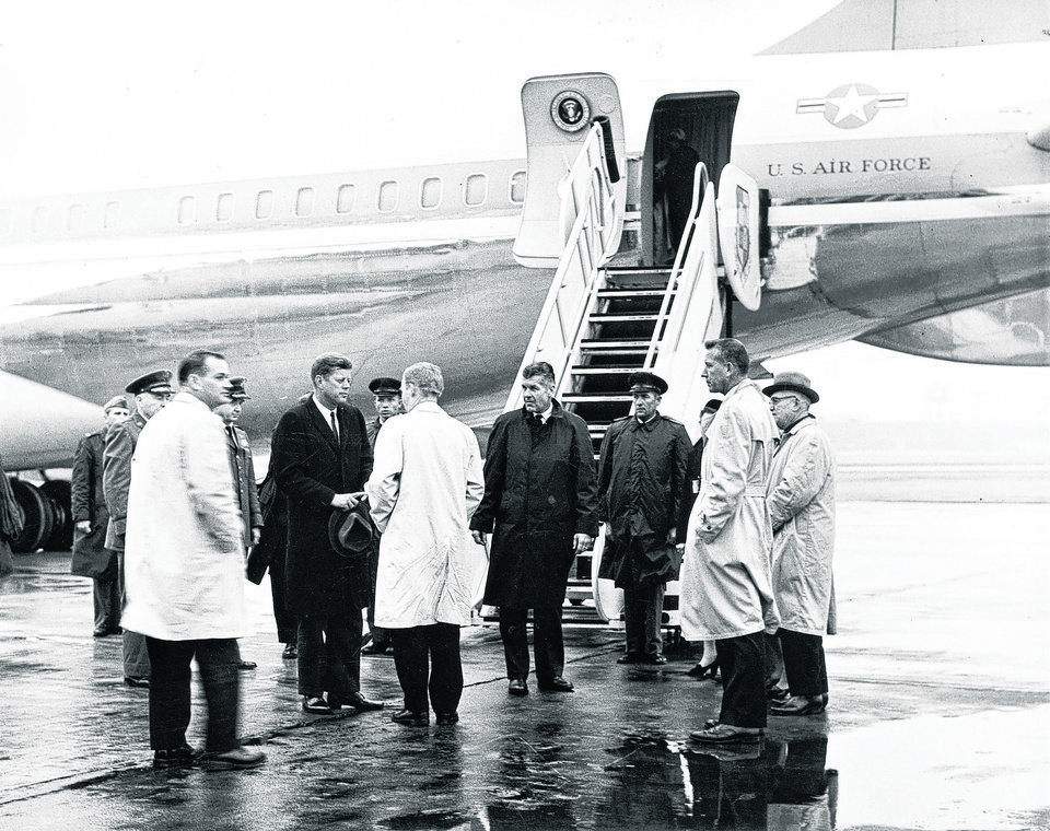 Photo - STATE, OKLAHOMA, VISIT, VISITS: President John F. Kennedy is greeted by Oklahoma Governor J. Howard Edmondson (in light coat facing President Kennedy) on President Kennedy's arrival Friday at Tinker Air Force Base for the funeral of Oklahoma Senator Robert S. Kerr. Sen. Kerr passed away 1/1/63. Staff photo by Richard