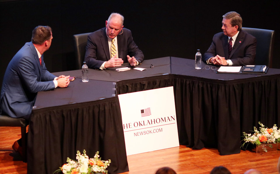 Photo - Candidates for Governor Kevin Stitt, left, and Drew Edmondson, right, with Chris Casteel as moderator during The Oklahoman's Gubernatorial Forum at the Oklahoma City Museum of Art, Monday, September, 24, 2018.  Photo by Doug Hoke, The Oklahoman