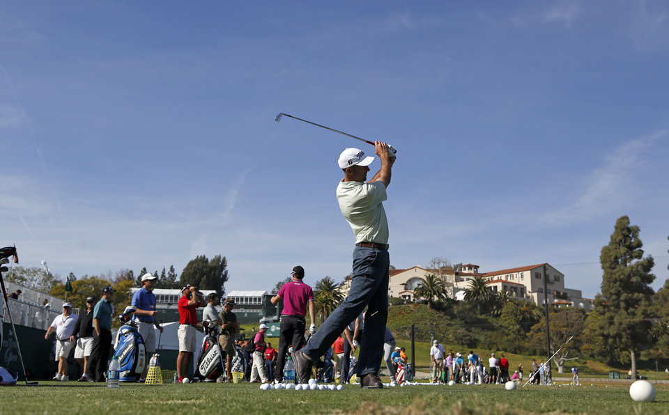 Photo - Geoff Ogilvy, of Australia, works on the driving range in the pro-am round of the Northern Trust Open golf tournament at Riviera Country Club in the Pacific Palisades area of Los Angeles on Wednesday, Feb. 12, 2014.  (AP Photo/Reed Saxon)
