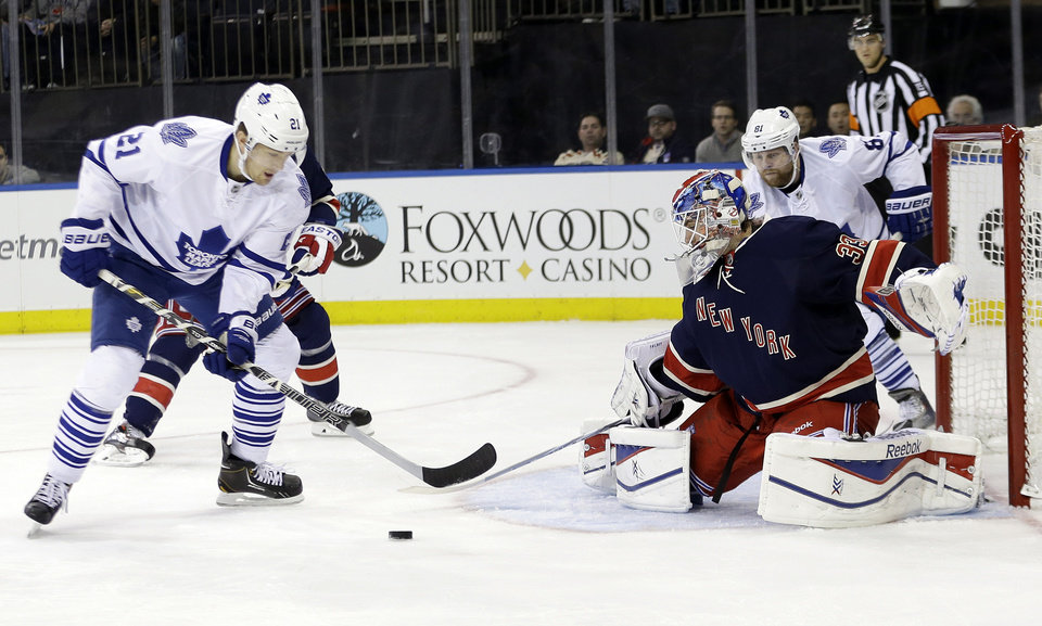 New York Rangers goalie Cam Talbot (33) stops a shot on the goal by Toronto Maple Leafs' James van Riemsdyk (21) during the first period of an NHL hockey game, Monday, Dec. 23, 2013, in New York. (AP Photo/Frank Franklin II)