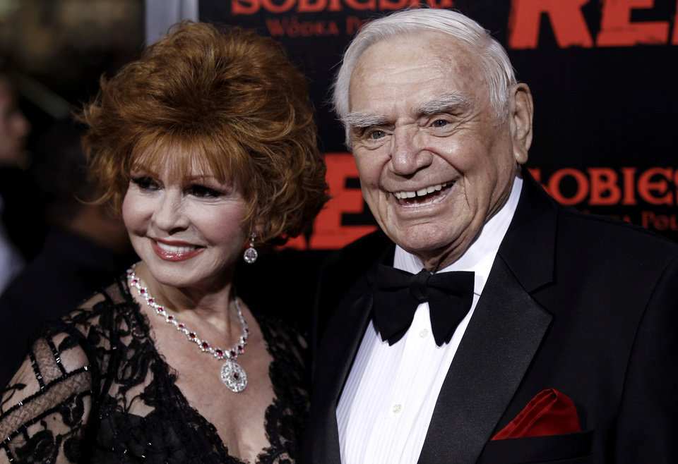 "FILE - In this Oct. 11, 2010, file photo, cast member Ernest Borgnine, right, and his wife, Tova, arrive at a special screening of the film ""Red"" in Los Angeles.  A spokesman said Sunday, July 8, 2012, that Borgnine has died at the age of 95. (AP Photo/Matt Sayles, File) ORG XMIT: NY803"