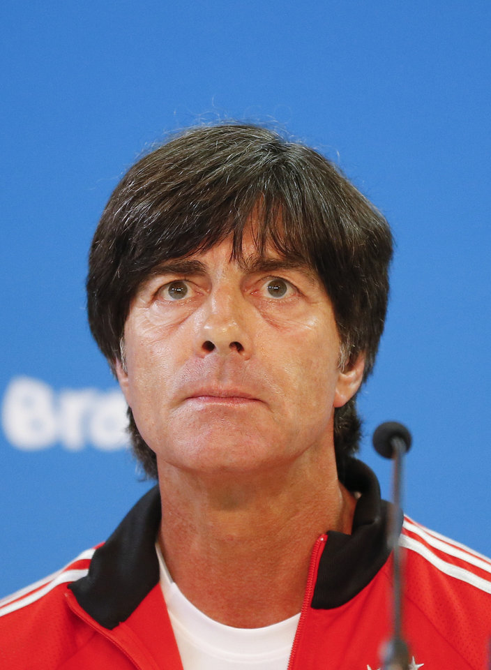 Photo - Germany's soccer team coach Joachim Loew listens during a press conference at the Estadio Beira-Rio Stadium in Porto Alegre, Brazil, Sunday, June 29, 2014. Germany will play Algeria in a World Cup round of 16 soccer match on June 30. (AP Photo/Frank Augstein)