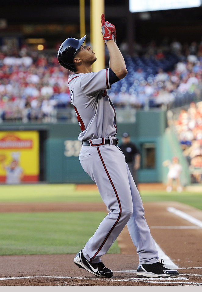 Photo - Atlanta Braves' Andrelton Simmons points to sky at home plate after hitting a solo home run in the first inning of a baseball game against the Atlanta Braves on Saturday, July 6, 2013, in Philadelphia. (AP Photo/Michael Perez)