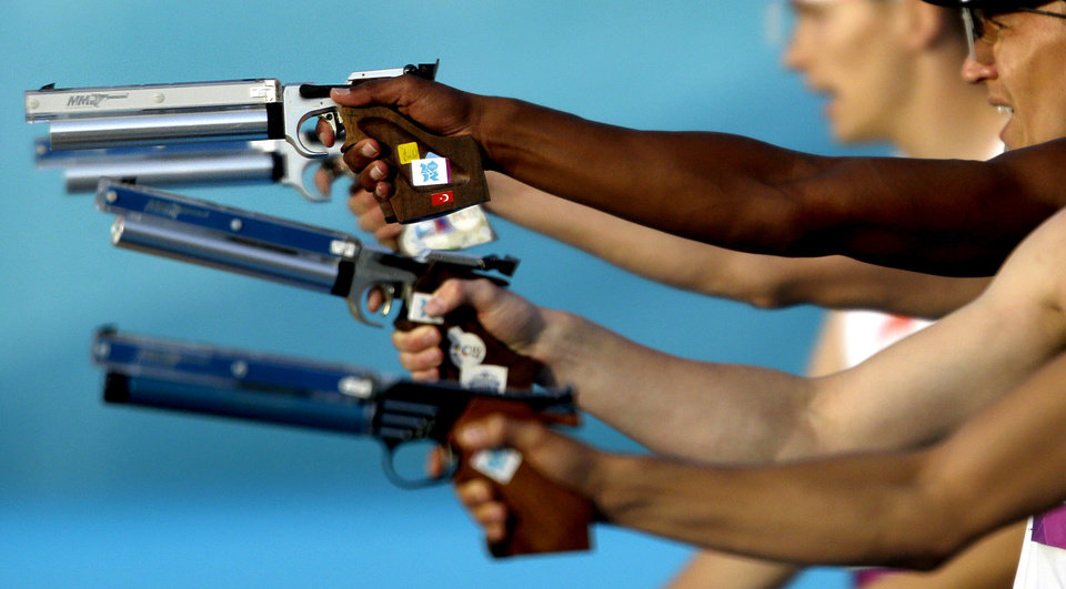 Photo -   Competitors take aim in the combination running and shooting stage of the men's modern pentathlon at the 2012 Summer Olympics, Saturday, Aug. 11, 2012, in London. (AP Photo/David Goldman)