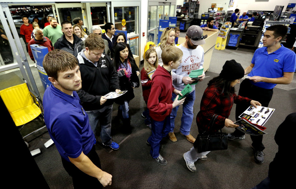 Photo - Shoppers get an early start on Black Friday at Best Buy on Thursday, Nov. 28, 2013, in Norman, Okla.  Photo by Steve Sisney, The Oklahoman
