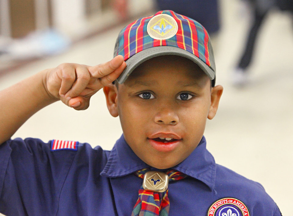 Nacio Griffith, 9, practices his Cub Scout salute during their pack meeting at Villa Teresa, Monday, March 7, 2011. Pack 543 includes some boys from the Positive Tomorrows program. Photo by David McDaniel, The Oklahoman