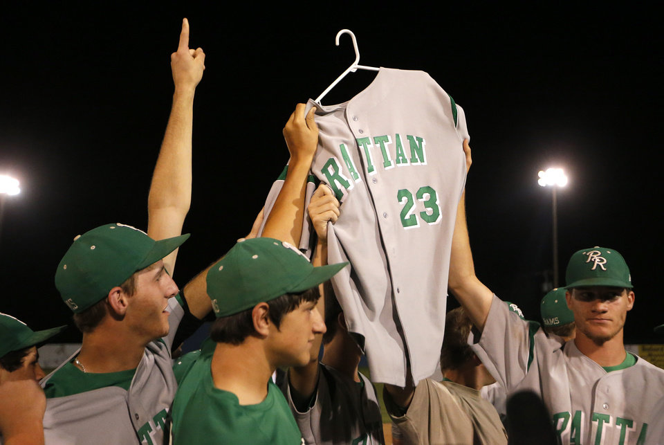 SPORTS / BASEBALL / HIGH SCHOOL BASEBALL / CLASS A HIGH SCHOOL STATE BASEBALL CHAMPIONSHIPS / ROFF HIGH SCHOOL / RATTAN HIGH SCHOOL: Rattan players hold up Brandon Jones jersey following their win over Roff in the Class A high school state baseball championships at Shawnee, Okla., Saturday, June 8, 2013. Photo by Sarah Phipps, The Oklahoman