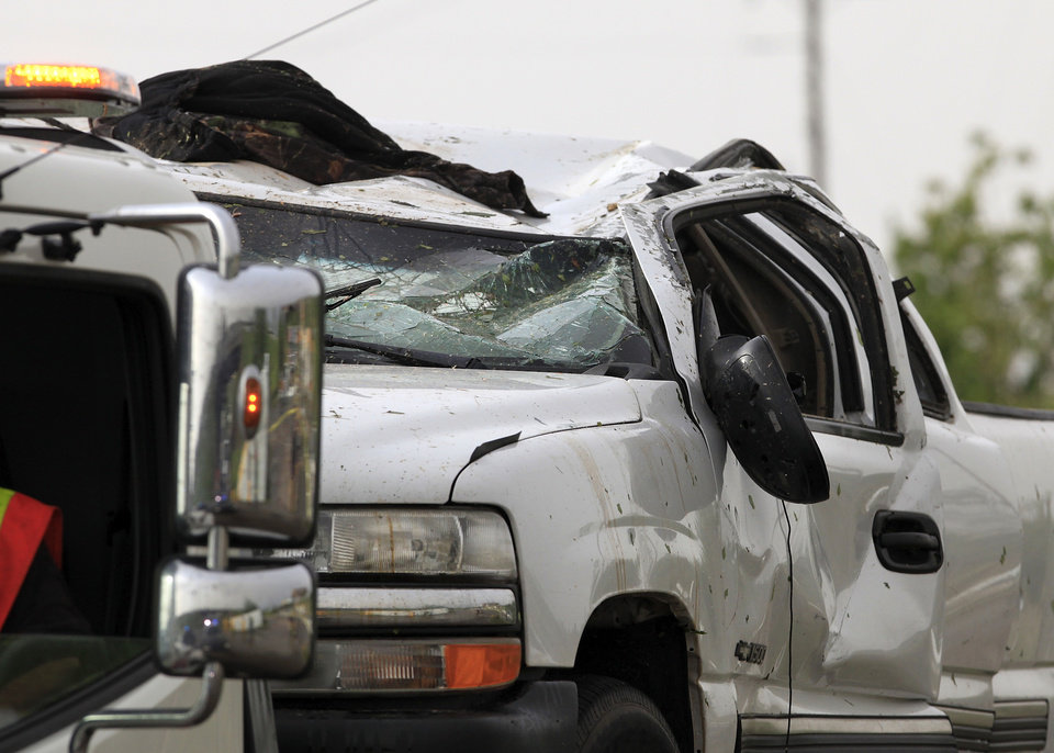 Photo - A truck damaged in the tornado that raced across eastern Oklahoma County sits on the bed of a wrecker before being removed from the area of SE 74 and Choctaw Rd., Monday evening, May 10, 2010.   Photo by Jim Beckel, The Oklahoman