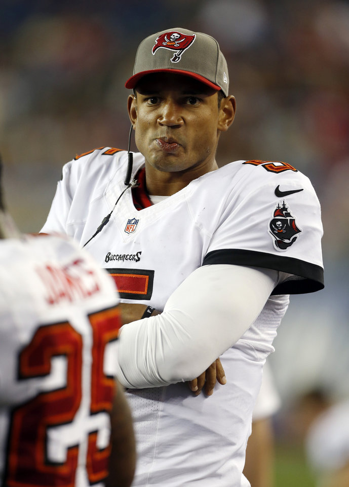 Photo - FILE - In this Aug. 16, 2013 file photo, Tampa Bay Buccaneers quarterback Josh Freeman watches from the sideline in the fourth quarter of an NFL preseason football game against the New England Patriots, in Foxborough, Mass. The Buccaneers have released Freeman, one week after benching the fifth-year pro in favor of rookie Mike Glennon. (AP Photo/Michael Dwyer, File)