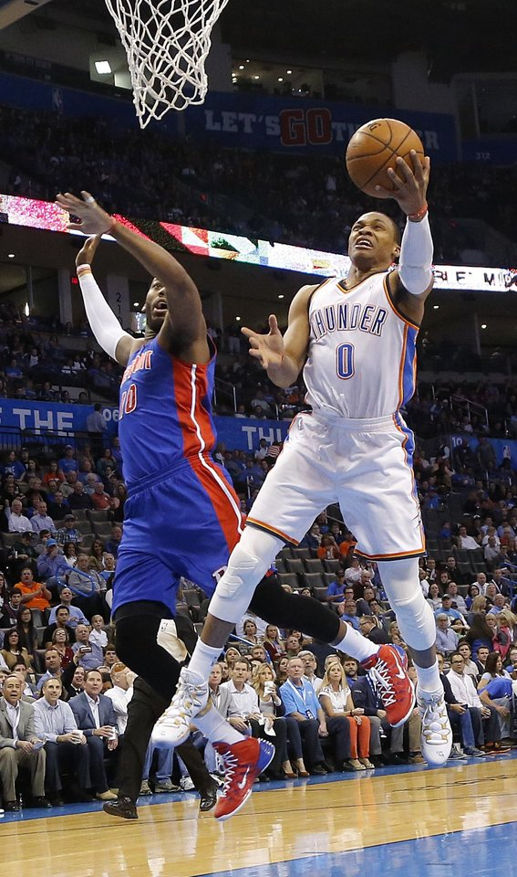 Photo - Oklahoma City's Russell Westbrook (0) drives past Detroit's Greg Monroe (10) for a shot during the NBA basketball game between the Oklahoma City Thuder and the Detroit Pistons at Chesapeake Energy Arena in Oklahoma City, Okla. on Wednesday, April 16, 2014.  Photo by Chris Landsberger, The Oklahoman