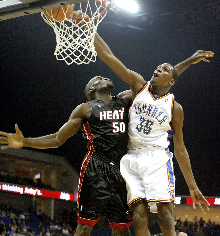Oklahoma City's Kevin Durant is fouled by Miami's Joel Anthony during an NBA preseason game between the Oklahoma City Thunder and the Miami Heat at the BOK Center in Tulsa, Okla., Wednesday, October 14, 2009. Photo by Bryan Terry, The Oklahoman