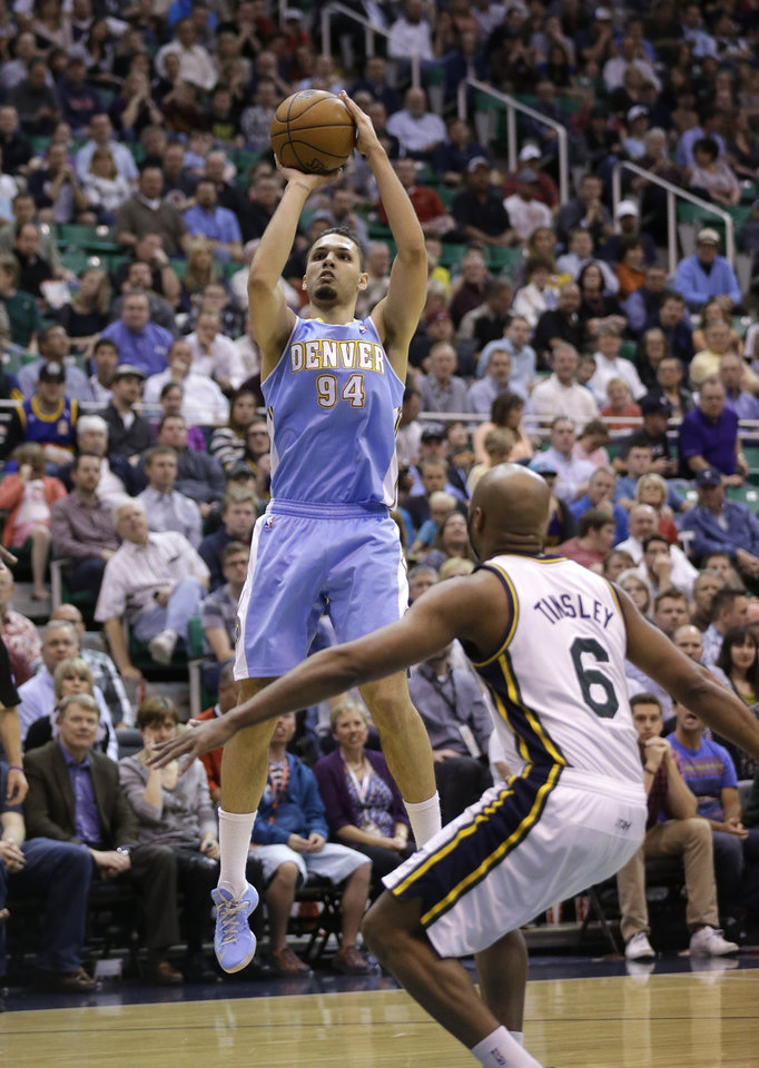 Denver Nuggets' Evan Fournier (94) shoots as Utah Jazz's Jamaal Tinsley (6) looks on in the second quarter during an NBA basketball game on Wednesday, April 3, 2013, in Salt Lake City. (AP Photo/Rick Bowmer)