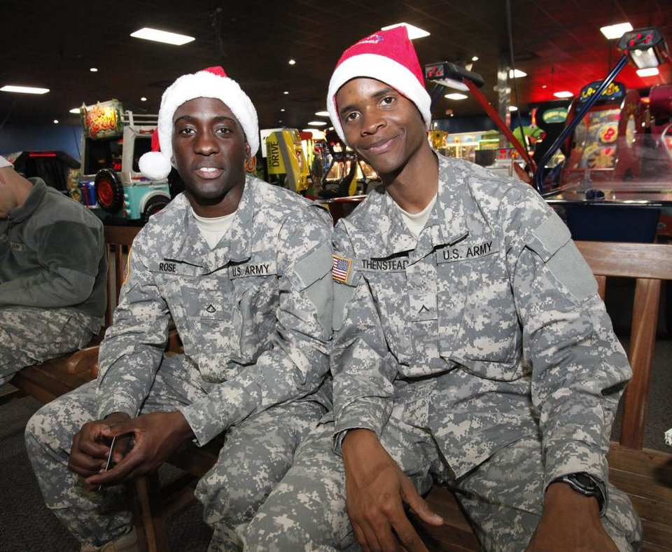 New recruits Kachieve Rose and Adrian Thenstead from Jamaica at a lunch stop at Gatti Town during Soldiers Day Out, Friday, December 21, 2012. Edmond/North OKC Blue Star Mothers will be taking the soldiers who can't go home for Christmas around the metro for a day of fun. Photo By David McDaniel/The Oklahoman