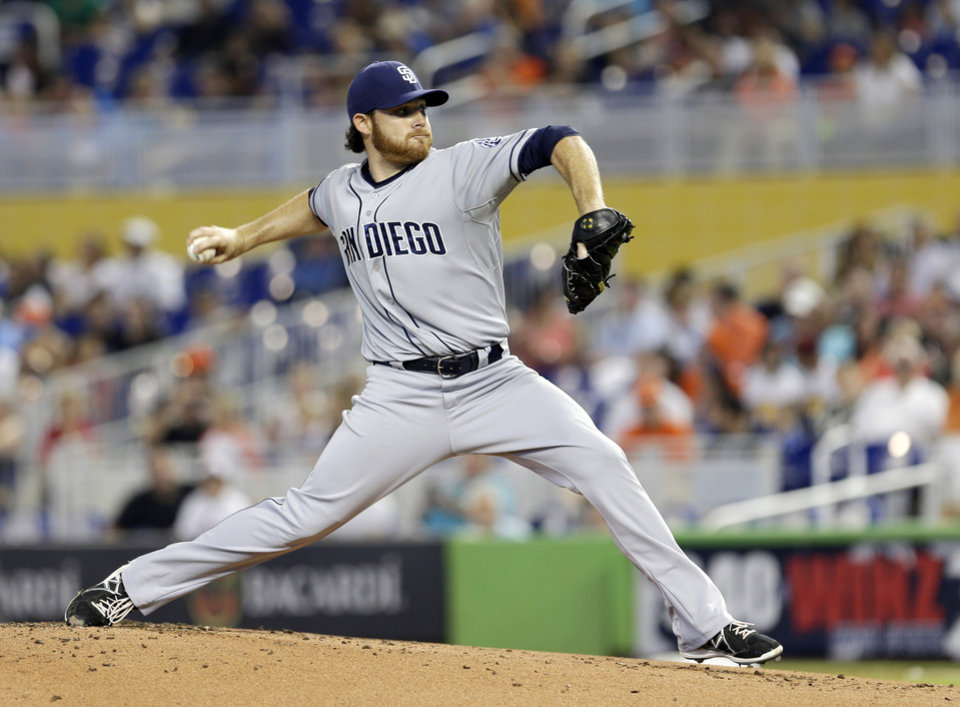 Photo - San Diego Padres' Ian Kennedy pitches against the Miami Marlins in the first inning of a baseball game in Miami, Sunday, April 6, 2014. (AP Photo/Alan Diaz)