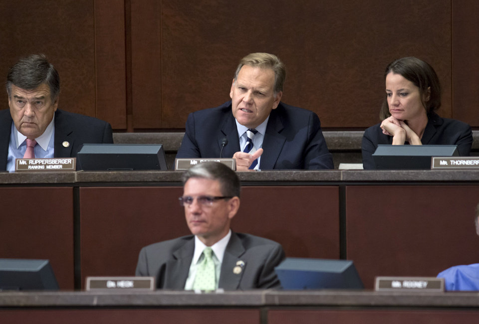 Photo -   House Intelligence Committee Chairman Rep. Mike Rogers, R-Mich., top center, and the committee's ranking Democrat, Rep. C.A.
