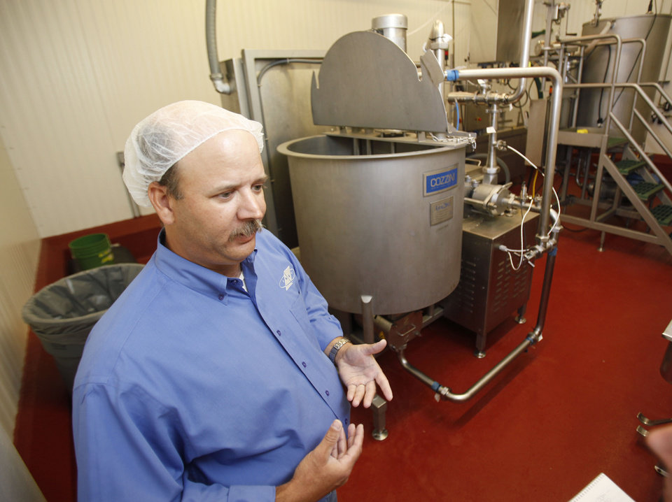 Meat Plant Manager Kyle Flynn discusses food preparation at OSU's Robert M. Kerr Food & Agricultural Products Center on the campus of Oklahoma State University in Stillwater, OK, Thursday, June 28, 2012,  By Paul Hellstern, The Oklahoman