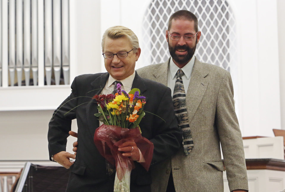 Photo - Same-sex marriages. Barry Bass and Kenny Wright walk down the aisle after their marriage at Mayflower Congregational Church, 3901 NW 63, Monday, October 6, 2014. Photo by David McDaniel
