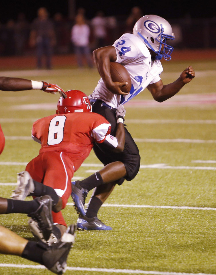Photo - CA #8 Tre Bruner hauls down GHS #24 Idea Alexander during the high school football game between Guthrie at Carl Albert in Midwest City, Friday, October 11, 2013.  Photo by Doug Hoke, The Oklahoman