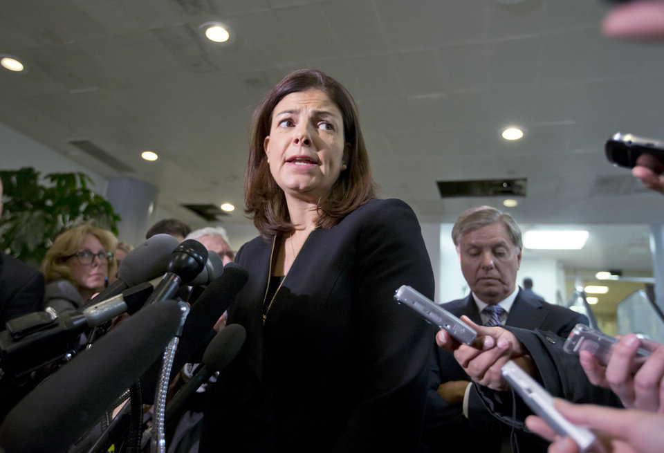 Photo - Senate Armed Services Committee member, Sen. Kelly Ayotte, R-N.H.,, center, accompanied by fellow Senate Armed Services Committee member, Sen. Lindsey Graham, R-S.C., right, speaks to reporters on Capitol Hill in Washington, Tuesday, Nov. 27, 2012, following a closed-door meeting with UN Ambassador Susan Rice.  (AP Photo/J. Scott Applewhite)