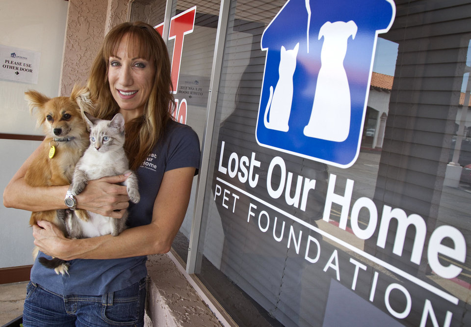 Photo - Jodi Polanski, founder and executive director of Lost Our Home Pet Foundation, stands outside her business July 12 in Phoenix.  AP Photo