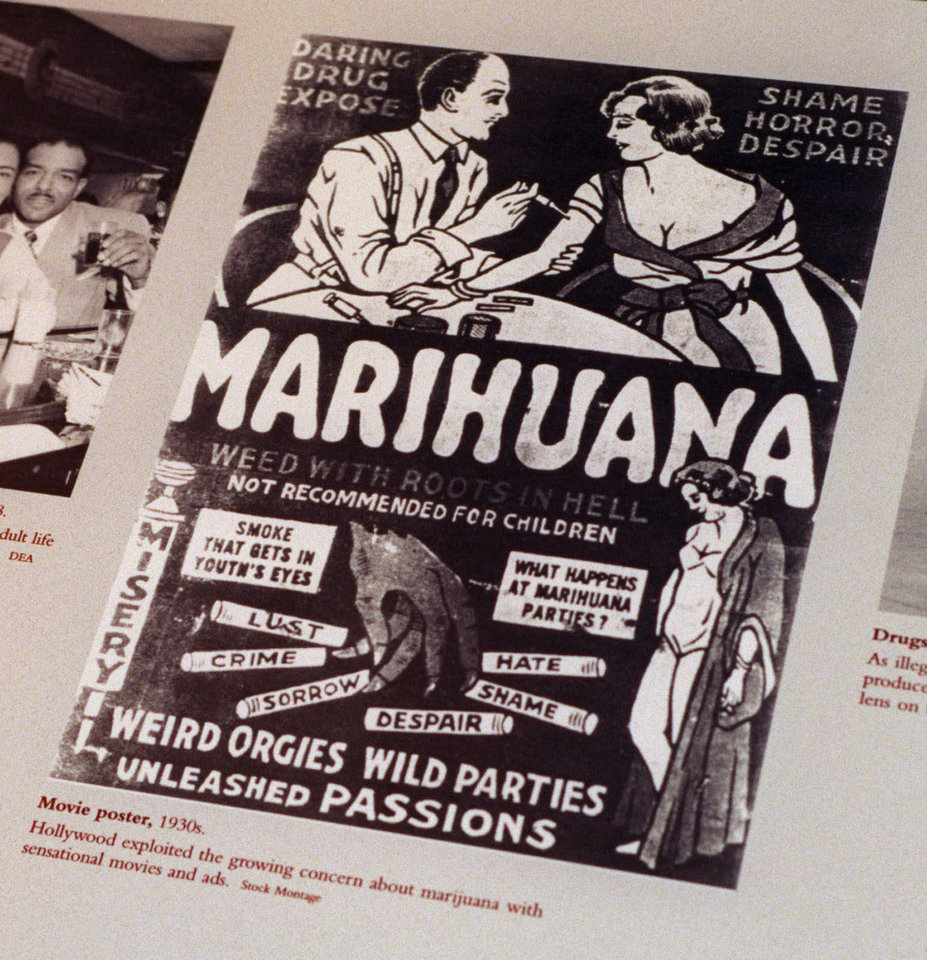 "FILE - This undated file photo provided by the Drug Enforcement Administration shows a 1930s anti-marijuana movie poster as part of an exhibit at the DEA Museum and Visitors Center which opened May 10, 1999 in Arlington, Va. After the repeal of alcohol prohibition in 1933, Harry Anslinger, who headed the Federal Bureau of Narcotics, turned his attention to pot. He told of sensational crimes reportedly committed by marijuana addicts. ""No one knows, when he places a marijuana cigarette to his lips, whether he will become a philosopher, a joyous reveler in a musical heaven, a mad insensate, a calm philosopher, or a murderer,"" he wrote in ""Marijuana: Assassin of Youth,"" in 1937. On the occasion of  ""Legalization Day,"" Thursday, Dec. 6, 2012, when Washington's new law takes effect, AP takes a look back at the cultural and legal status of the ""evil weed"" in American history. (AP Photo/DEA, File)"