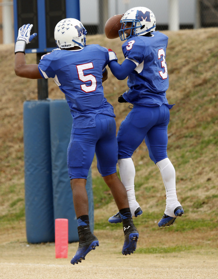 Photo - Millwood's Cameron Batson(3) celebrates his touchdown run with Quincy Dotson as the Falcons play Hobart in high school football playoff action on Saturday, Nov. 23, 2013, in Oklahoma City, Okla. Photo by Steve Sisney, The Oklahoman