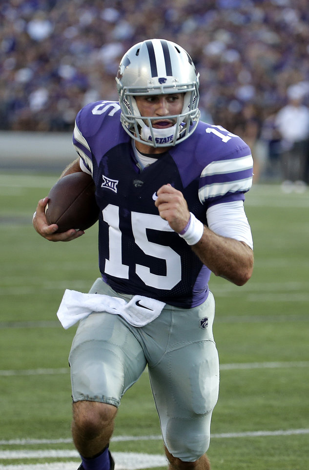 Photo - Kansas State quarterback Jake Waters (15) runs into the end zone to score a touchdown during the first half of an NCAA college football game against Stephen F. Austin Saturday, Aug. 30, 2014, in Manhattan, Kan. (AP Photo/Charlie Riedel)
