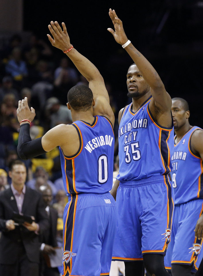 Photo - Oklahoma City's Russell Westbrook (0) and Kevin Durant (35) celebrate during Game 6  in the first round of the NBA playoffs between the Oklahoma City Thunder and the Memphis Grizzlies at FedExForum in Memphis, Tenn., Thursday, May 1, 2014. Photo by Bryan Terry, The Oklahoman