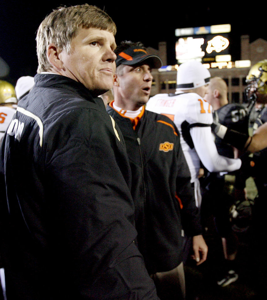Photo - Colorado coach Dan Hawkins and OSU coach Mike Gundy greet each other after the college football game between Oklahoma State University and the University of Colorado at Folsom Field in Boulder, Colo., Saturday, Nov. 15, 2008. BY BRYAN TERRY, THE OKLAHOMAN