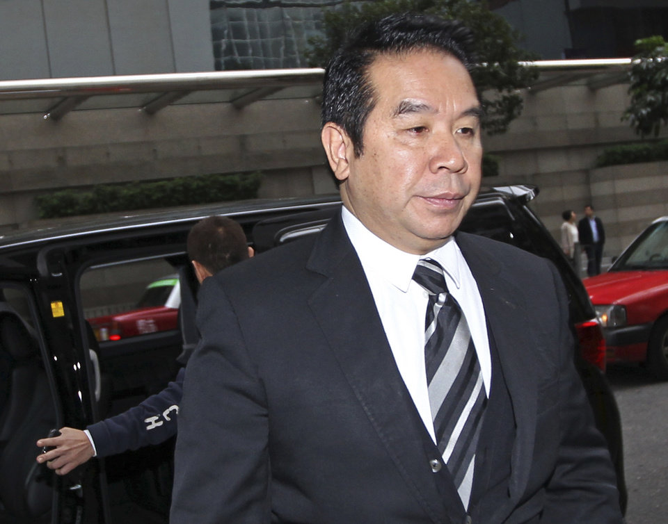 Photo - Hong Kong businessman Carson Yeung, also owner of Birmingham City football club, arrives for the verdict in his money laundering trial at Hong Kong District Court Monday, March 3, 2014. Yeung was found guilty of money laundering by the Hong Kong District Court and was convicted over charges relating to his handling of 721 million Hong Kong dollars ($93 million) using five bank accounts between January 2001 and December 2007. (AP Photo)