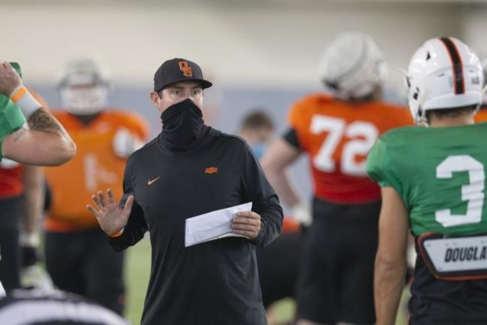 Photo -  Oklahoma State quarterback coach Tim Rattay talks with starting quarterback Spencer Sanders during a recent practice. [Bruce Waterfield/Courtesy of OSU Athletics]