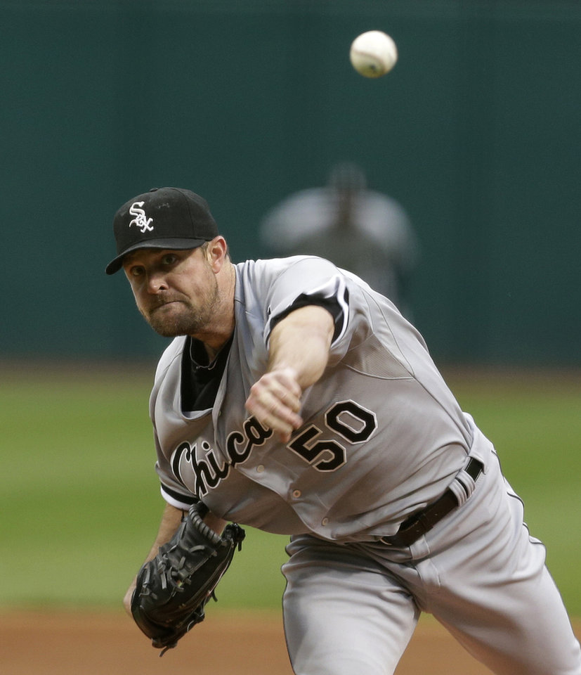 Photo - Chicago White Sox starting pitcher John Danks delivers in the first inning of a baseball game against the Cleveland Indians, Monday, July 29, 2013, in Cleveland. (AP Photo/Tony Dejak)