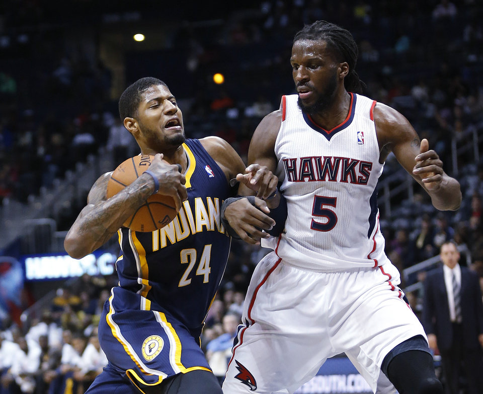 Indiana Pacers small forward Paul George (24) drives against Atlanta Hawks small forward DeMarre Carroll (5) in the first  half of an NBA basketball game, Tuesday, Feb. 4, 2014, in Atlanta. (AP Photo/John Bazemore)