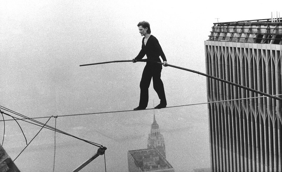 "FILE - In this Aug. 7, 1974 file photo, Philippe Petit, a French high wire artist, walks across a tightrope suspended between the World Trade Center's Twin Towers in New York. Philippe Petit stars in ""Man on a Wire,"" directed by James Marsh. (AP Photo/Alan Welner, File)"