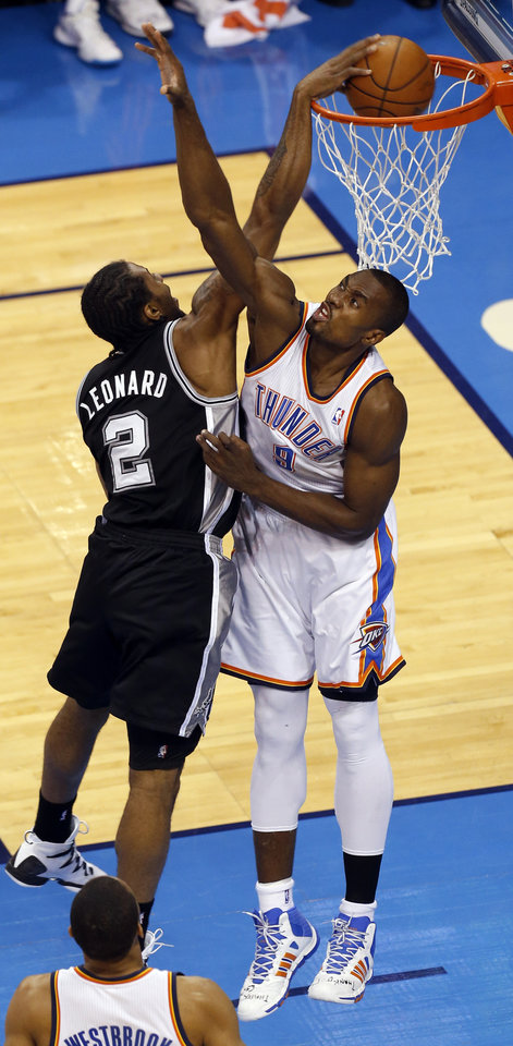 Photo - San Antonio's Kawhi Leonard (2) dunks over Oklahoma City's Serge Ibaka (9) during Game 6 of the Western Conference Finals in the NBA playoffs between the Oklahoma City Thunder and the San Antonio Spurs at Chesapeake Energy Arena in Oklahoma City, Saturday, May 31, 2014. Photo by Nate Billings, The Oklahoman