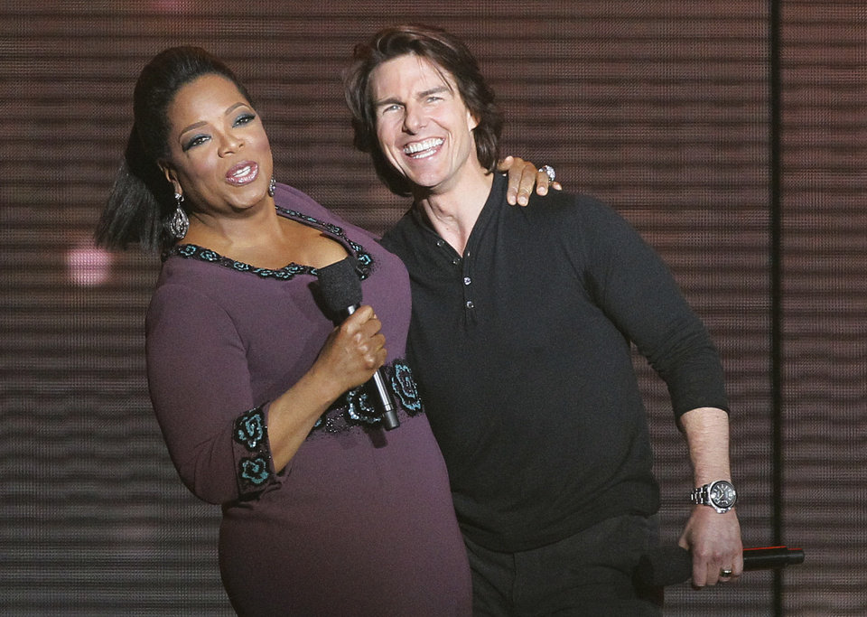 Photo -   FILE - In this May 17, 2011 file photo, Tom Cruise, right, appears with Oprah Winfrey during a star-studded double-taping of