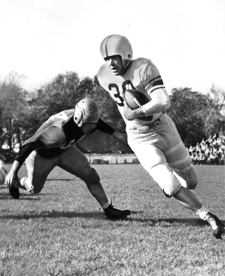 Photo - Joe Golding picked up 22 yards on this jaunt during the first quarter at Ames in 1946 as the University of Oklahoma took the wind out of the Iowa State Cyclones, 63-0, to post its second straight Big Six conference win. Jim Ridding, Iowa State center, finally pulled down Golding, who started out on his own 30-yard stripe.  More than 16,000 fans watched the powerful Sooners in action. OKLAHOMAN ARCHIVE PHOTO