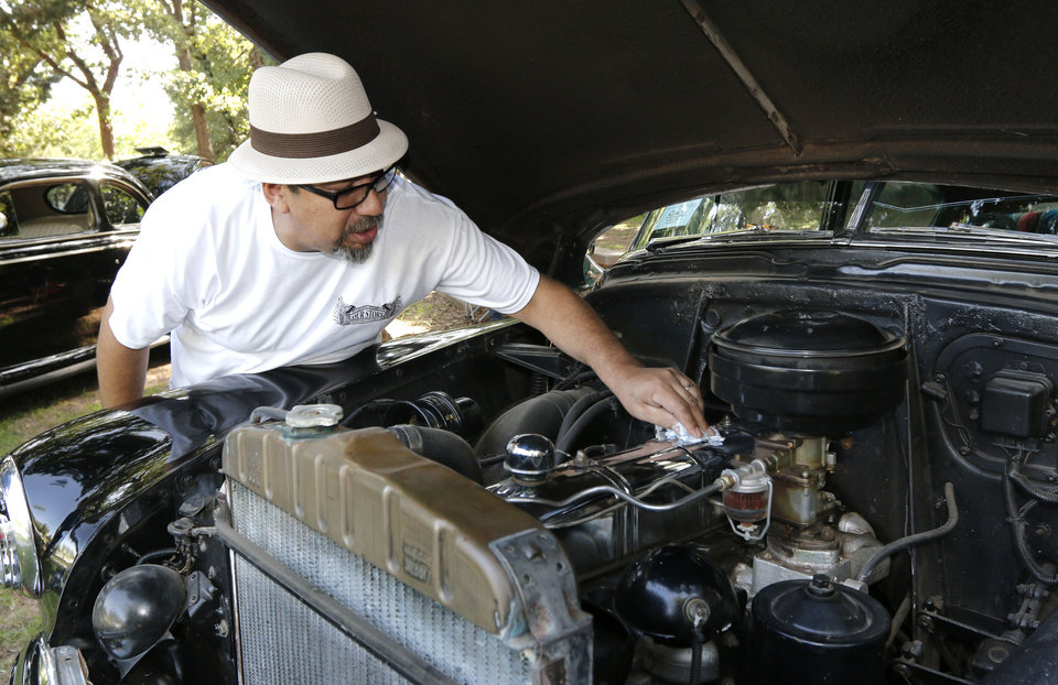 Photo - Jessie Rivera polishes the motor of his 1951 Chevy during a car show, part of Bethany's Fourth of July celebration at Eldon Lyon Park in Bethany, OK, Friday, July 4, 2014,  Photo by Paul Hellstern, The Oklahoman