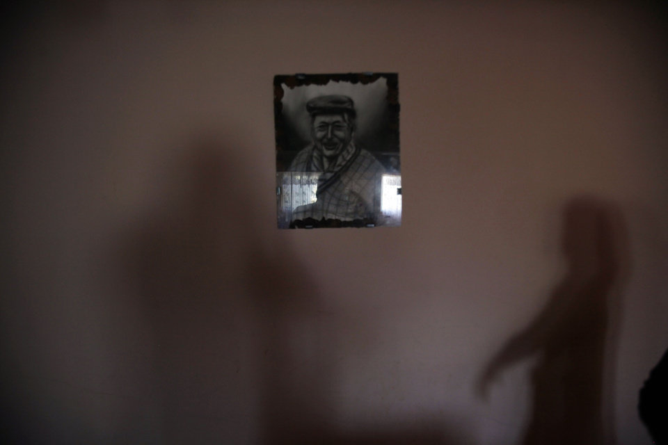 In this photo taken Nov. 29, 2012, after experiencing many tremors and earthquakes, a framed picture of Evelyn Perez's grandfather is the only picture left accentuating a wall in her one-story home in Navidad, Chile. Some of the highest seismic activity on Earth is found in Chile. After so many tremors, Navidenos have learned the magnitudes by heart. They know they'll barely feel a magnitude two, but a magnitude seven will knock them off their feet and it's a sign to dash for higher ground to avoid being rolled-in by a tsunami wave.  (AP Photo/Luis Hidalgo)