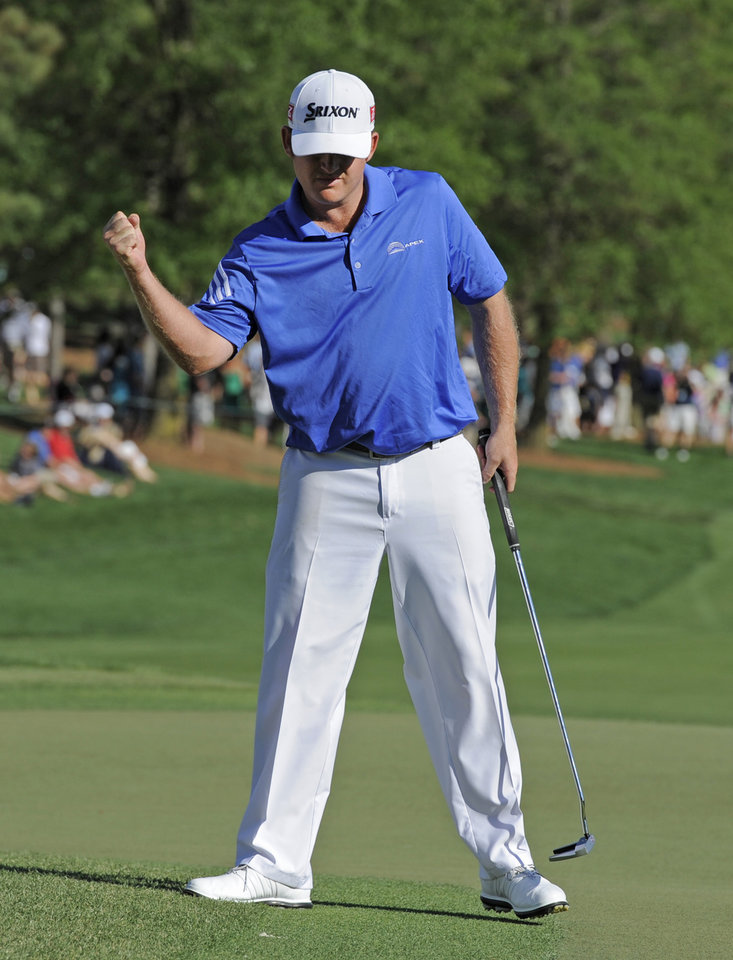 Photo - J.B. Holmes pumps his fist after making a birdie putt on the 18th hole during the third round of the Wells Fargo Championship golf tournament in Charlotte, N.C., Saturday, May 3, 2014. (AP Photo/Mike McCarn)
