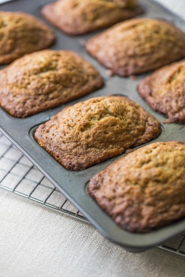 Photo -  Mini banana bread. Setting out breakfast for your guests to help themselves when they wake up in the morning is a low-stress, make ahead way for you to offer the morning meal. [Sarah Crowder/Katie Workman via AP]