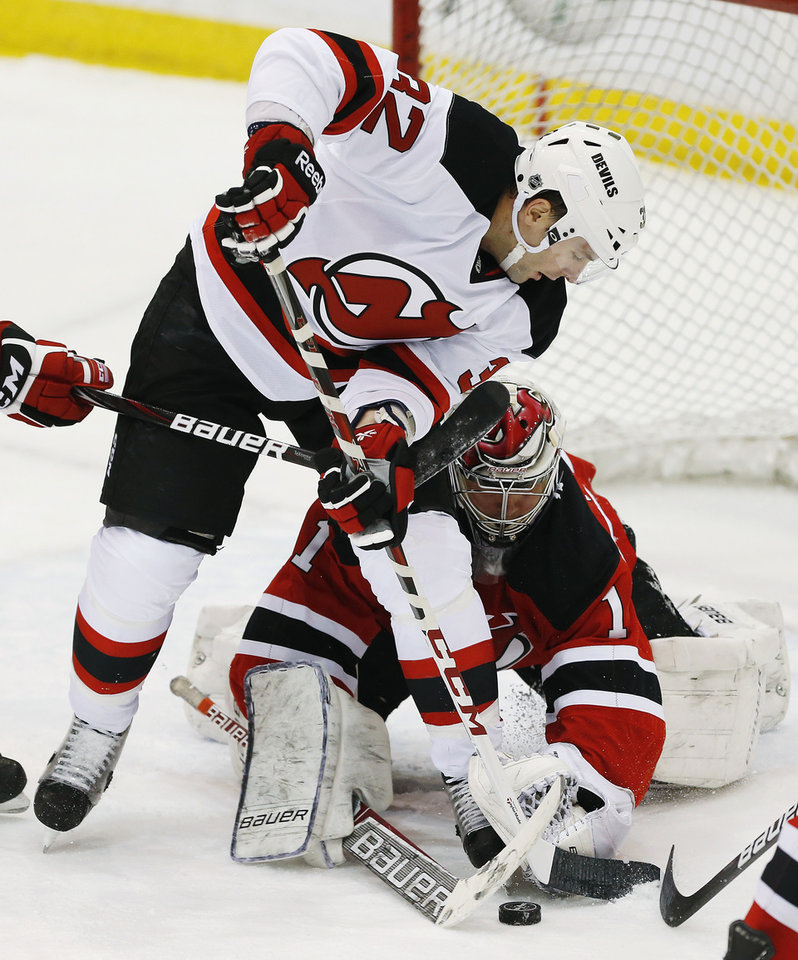 New Jersey Devils\' Mathiew Darche, top, tries to score against Devils goalie Johan Hedberg (1), of Sweden, during an NHL hockey scrimmage, Wednesday, Jan. 16, 2013, in Newark, N.J. (AP Photo/Julio Cortez)