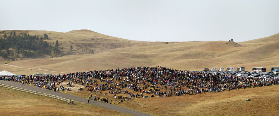 Photo -   More than 1,000 buffalo thunder across the prairie land Monday, Sept. 24, 2012, during the 47th annual Buffalo Roundup in western South Dakota's Custer State Park. Event organizers estimate that more than 14,000 people attended the event. (AP Photo/Kristi Eaton)