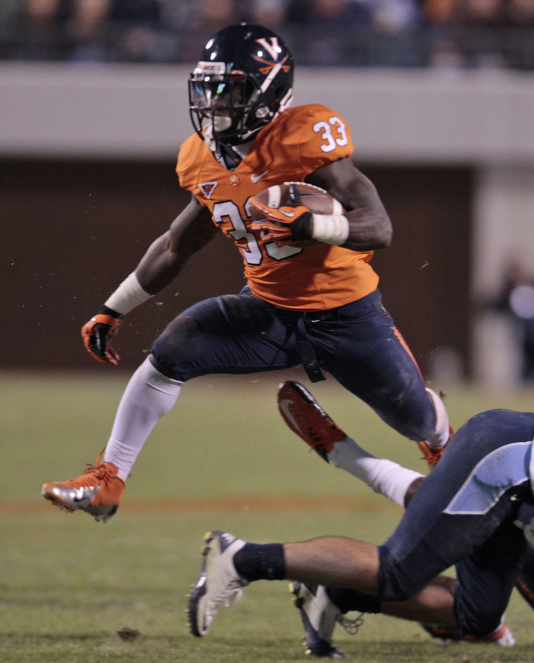 Photo -   Virginia running back Perry Jones (33) hurdles a player as he gains yardage during the first half of an NCAA college football game at Scott stadium Thursday, Nov. 15, 2012 in Charlottesville, VA ( P Photo/Steve Helber)