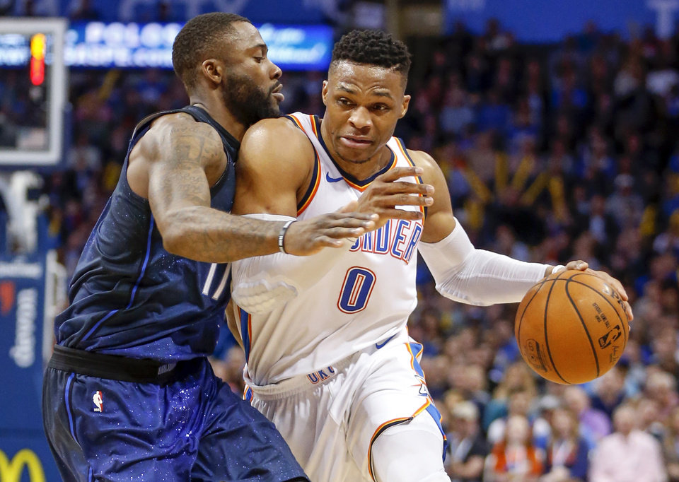 Photo -  Oklahoma City's Russell Westbrook drives against Orlando's Jonathon Simmons during Monday's game. [Photo by Nate Billings, The Oklahoman]