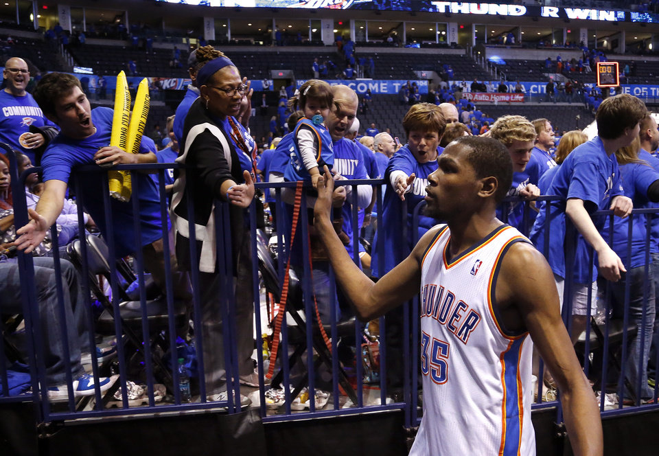 Photo - Oklahoma City's Kevin Durant (35) high fives fans following Game 1 in the second round of the NBA playoffs between the Oklahoma City Thunder and the Memphis Grizzlies at Chesapeake Energy Arena in Oklahoma City, Sunday, May 5, 2013. Photo by Sarah Phipps, The Oklahoman