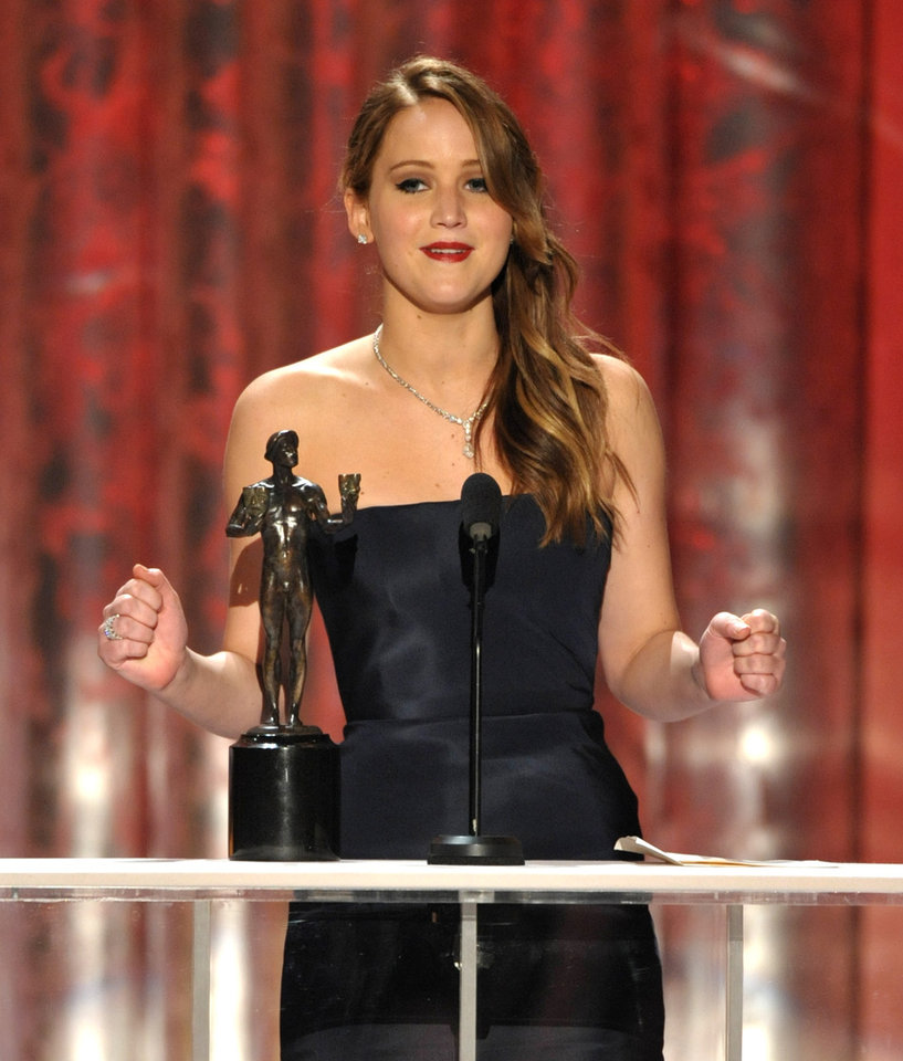 "Photo - Jennifer Lawrence accepts the award for outstanding female actor in a leading role for ""Silver Linings Playbook"" at the 19th Annual Screen Actors Guild Awards at the Shrine Auditorium in Los Angeles on Sunday Jan. 27, 2013. (Photo by John Shearer/Invision/AP)"