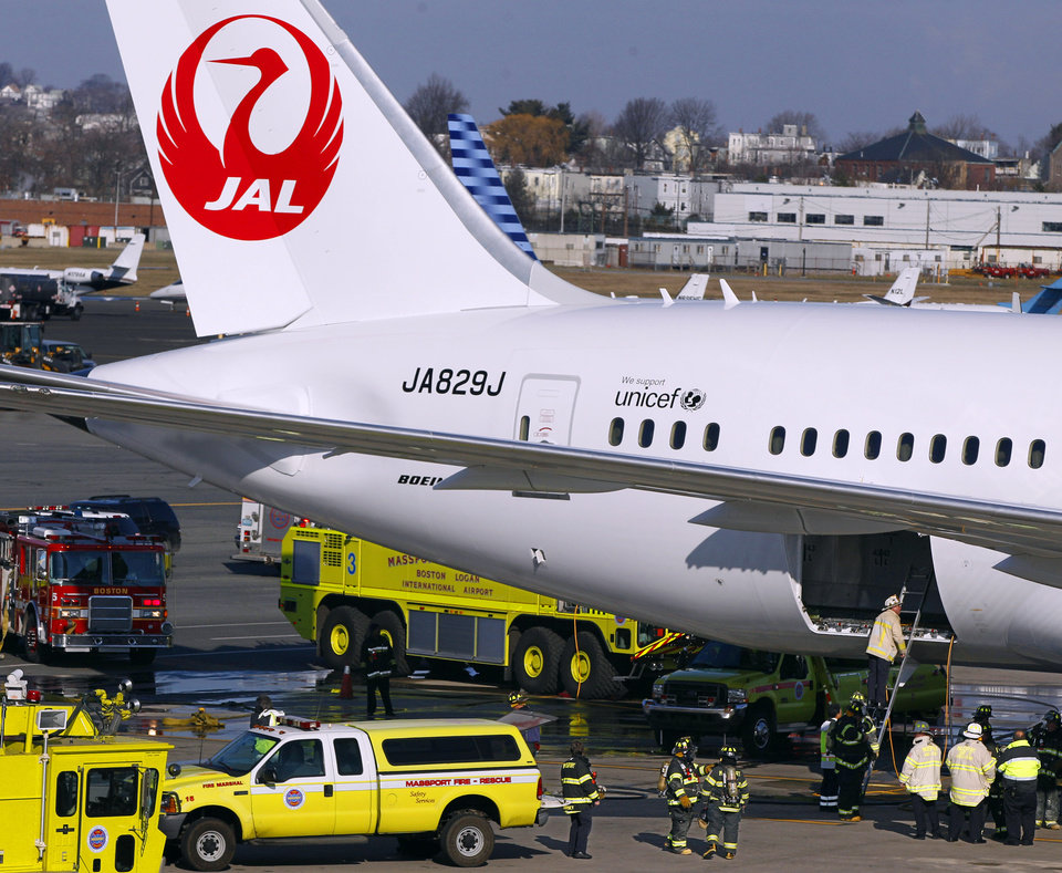 FILE - In this Jan. 7, 2013, file photo, a Japan Airlines Boeing 787 jet aircraft is surrounded by emergency vehicles while parked at a terminal E gate at Logan International Airport in Boston as a fire chief looks into the cargo hold. Congress has been strangely silent as Boeing, its airline customers and federal safety regulators struggled over the past two months to solve problems with the new Boeing 787 fire-plagued batteries. The unusual bipartisan silence reflects Boeing�s political clout, wielded by legions of lobbyists, fueled by hefty political campaign contributions and by the company�s importance as a huge employer and the nation�s single largest exporter. (AP Photo/Stephan Savoia, File)