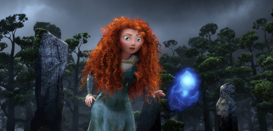FILE - In this undated publicity film image released by Disney/Pixar, the character Merida, voiced by Kelly Macdonald, follows a Wisp in a scene from