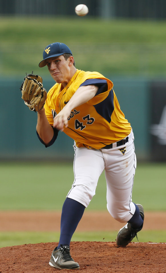 West Virginia's John Means (43) pitches during an NCAA baseball game between Oklahoma State and West Virginia in the Big 12 Baseball Championship tournament at the Chickasaw Bricktown Ballpark in Oklahoma City, Saturday, May 25, 2013. WVU beat OSU 6-5 in ten innings. Photo by Nate Billings, The Oklahoman